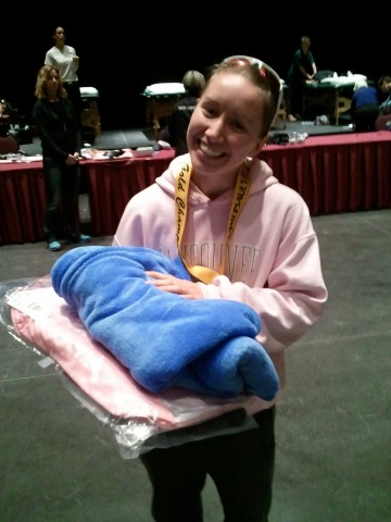 She won her medal, a cozy blanket and a couple gym bags but more importantly it was a great confidence boost for her.